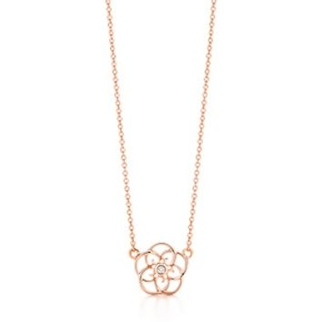 Tiffany & Co. -  Paloma Picasso® Loving Heart swirl pendant in 18k rose gold with a diamond.