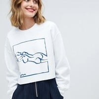 Reclaimed Vintage inspired long sleeve sweat in white with art print at asos.com