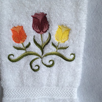 Embroidered bathroom hand towel with colorful tulips.