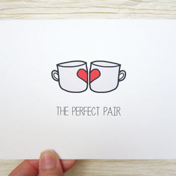 "Cute Valentine. Valentines Day Card. ""The perfect pair."" Coffee mugs. Tea mugs."