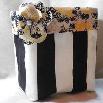 Black and White Striped Fabric Basket With Yellow and Black Floral Liner
