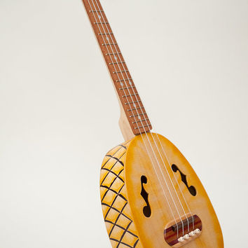 Pineapple ukulele  (relief carved sides and back)