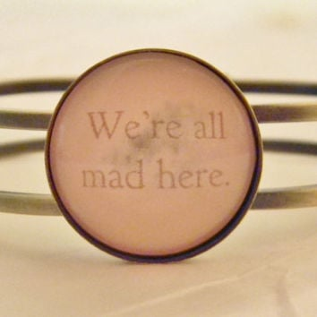 Cheshire Cat Quote Bracelet. We're All Mad Here Alice in Wonderland Bracelet. Antique Brass Tone Bangle.