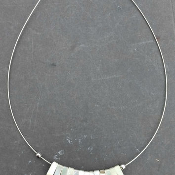 Mother of Pearl, white shell and silver metal necklace. Graduated pendant.