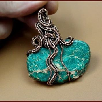 Wire wrapped pendant. Pendant made of copper wire and cut of natural variscite. Handmade copper jewelry.