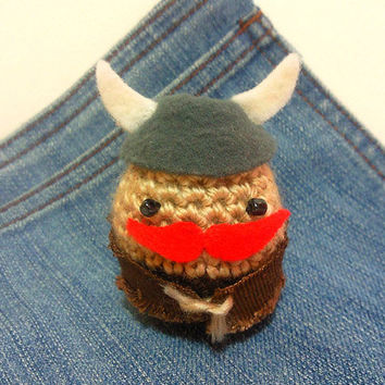 Amigurumi crochet Viking with mustache plush toy.