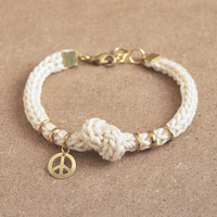 Cream rope bracelet with knot, knit cord bracelet with peace charm, peace bracelet