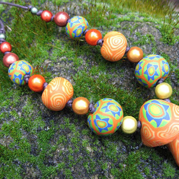 Millefiori mushroom pendant necklace handmade in orange and green with spirals and stars on thin adjustable cord