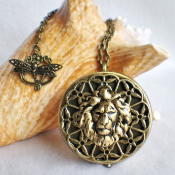 Music box locket, round locket with music box inside, in bronze with lion and bronze filigree.