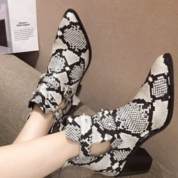 A new fashion high heel thick heel snake-print ankle boots for women