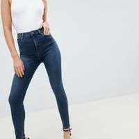 ASOS DESIGN Ridley high waist skinny jeans in greyed blue wash at asos.com