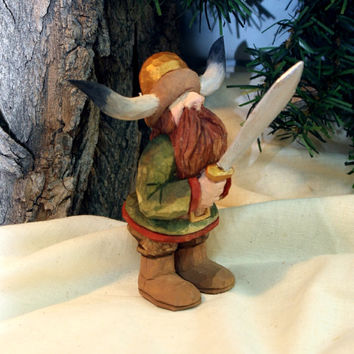 Small hand carved wood Viking with horned helmet, sword, and red beard by Dan Easley