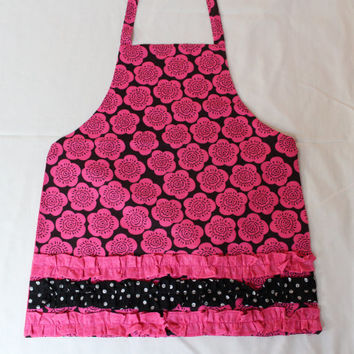 Little girls pink and black flowered apron with ruffles