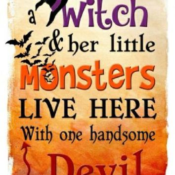 A Witch and Her Little Monsters Live Here Metal Front Porch Sign