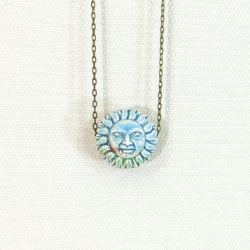 Sun and moon reversible necklace with blue celestial crescent moon pendant
