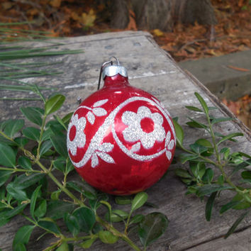 Christmas Ornament 70's Red features Silver Glitter
