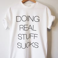 JUSTIN BIEBER Doing Real Stuff Sucks T-SHIRT Standard, Slim and Ladies Sizes High Quality Screen Print - The Best Quality available