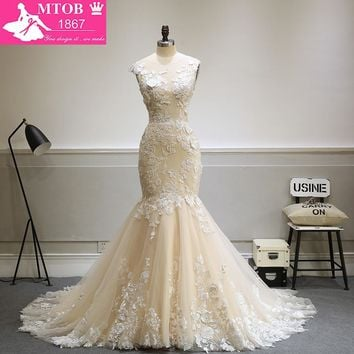 Designer Sexy Mermaid Lace Wedding Dress 2017 Champagne Backless See Through Robe De Mariage MTOB1734