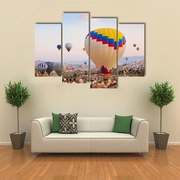 Hot Air Balloon Flying Over Cappadocia Multi Panel Canvas Wall Art