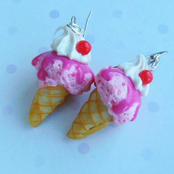 polymer clay strawberry ice cream earrings with whipped cream and cherries in a waffle cone