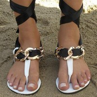 White, black and gold toe post sandals from Chockers Shoes