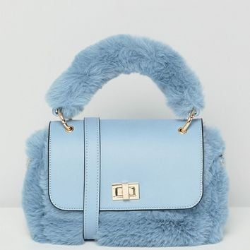 ASOS DESIGN mini faux fur bag with detachable strap at asos.com