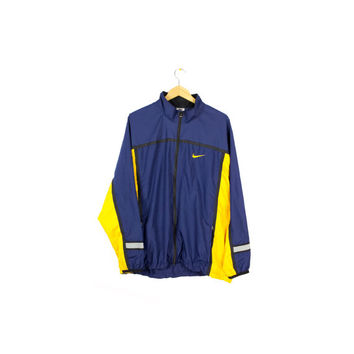 90s NIKE windbreaker jacket / vintage 1990s / navvy blue + yellow / swoosh logo / mens L - XL