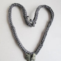Hand knotted necklace charcoal gray cotton yarn with green Prasiolite crystal spears as focal point An Astrid Endeavor allergy free jewelry