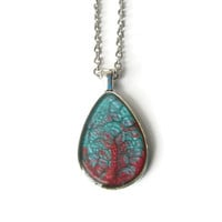 Teardrop Pendant necklace with metallic turquoise and red in silver tone teardrop bezel