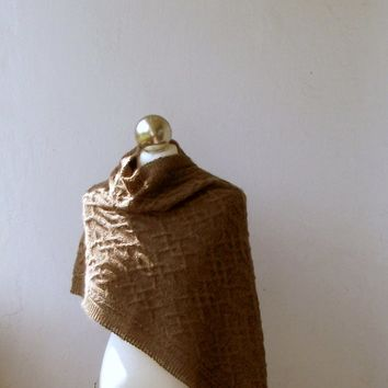 Brown hand knitted  alpaca shawl with celtic cable motifs