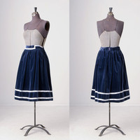 vintage full skirt made of soft navy blue velvet with two white satin stripes around bottom and white satin detail on waistband