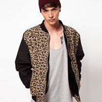 Reclaimed Vintage Varsity Jacket with Leopard Print Tapestry Panel at asos.com