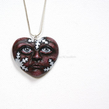 OOAK dark heart pendant: Love Is Winter! One of a kind air dry clay heart portrait sculpture with snowflakes, original art as jewelry