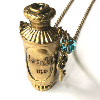 Drink Me Potion necklace, magic liquid bottle and key charms accented with blue crystal