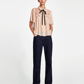 RUFFLED BLOUSE WITH BOW DETAILS