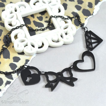 SIMPLY CHARMING - Black Laser Cut Acrylic Charm Necklace Featuring a Bow, Padlock, Heart, Diamond