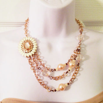 Ivory pendant with chunky gold chain statement necklace with pink accents