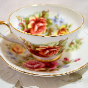Tea Cup and Saucer in Porcelain Yellow and Pink Flowers , Set for Tea Royal Sutherland Staffordshire