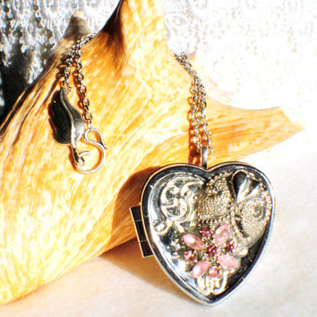 Music box locket, heart shaped locket with music box inside, in silver with vintage rhinestone adornments