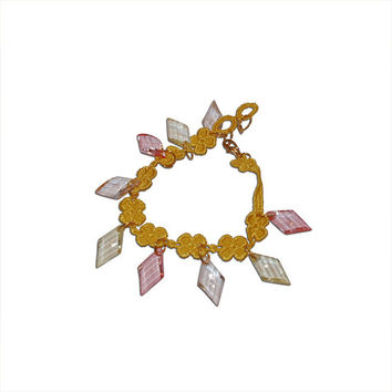 Yellow Flower Patterned Fabric Bracelet with Yellow, Peach, and Pink Beads