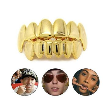 ac DCCKO2Q KUNIU Hip Hop Gold Colors Teeth Grillz Caps Top & Bottom Bling Teeth Silicone Set for Vampire Holloween Party Gifts Body Jewelry
