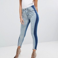 PrettyLittleThing Distressed Hem Jeans With Contrast Side at asos.com