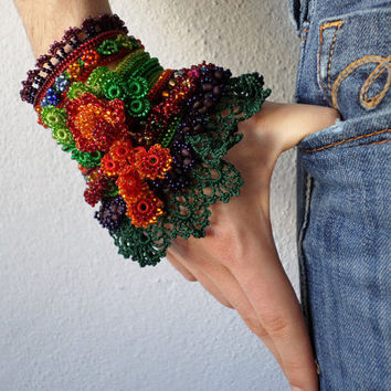 beaded freeform crochet cuff - bracelet with beaded crochet flowers and green crochet lace