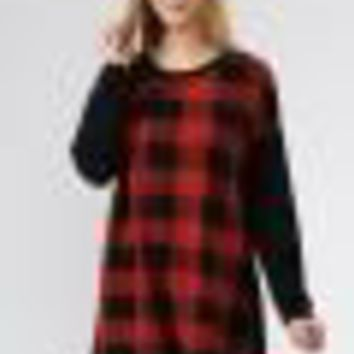 Knit plaid print top with button detail on back.