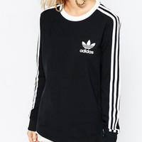 adidas Originals Adicolour Long Sleeve Top With 3 Stripe Logo at asos.com