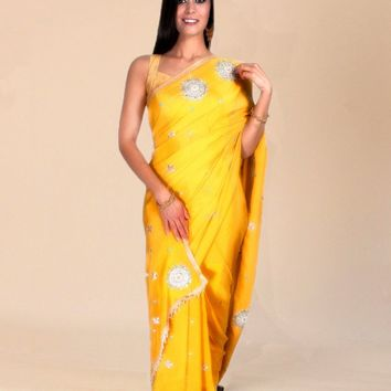 the pure crepe silk saree in yellow with sundial sequins