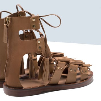Tasseled leather roman sandals