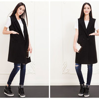 womens vest in black,long length,double-breasted,casual,minimalist style,high fashion,chic.--E0297