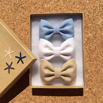 Blue chambray, white linen, and tan linen hair bows from seaside sparrow.