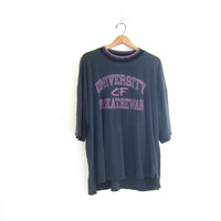 20% OFF SALE Vintage oversized and worn in tee shirt / University of Saskatchewan tshirt with aztec print collar